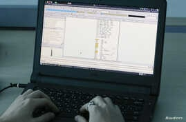 A laptop shows part of a code, which is the component of Petya malware computer virus, according to representatives of Ukrainian cybersecurity firm ISSP, at the firm's office in Kyiv, Ukraine, July 4, 2017.