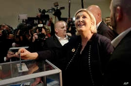 French far-right presidential candidate, Marine Le Pen casts her vote, in Lille, northern France, March 10, 2018.