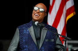 FILE - Singer Stevie Wonder performs at the dedication ceremony for the Smithsonian Museum of African American History and Culture on the National Mall in Washington, Sept. 24, 2016.