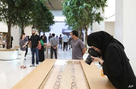 A photographer takes a photo of apple watches at the Apple Store ahead of their grand opening in Dubai, United Arab Emirates, Oct. 27, 2015