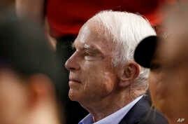 FILE - In this Aug. 10, 2017, file photo, Sen. John McCain, R-Ariz., watches a baseball game between the Arizona Diamondbacks and the Los Angeles Dodgers in Phoenix.