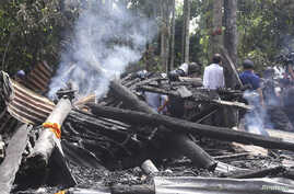 A Buddhist temple burnt by Muslims is seen in Cox's Bazar, Bangladesh, September 30, 2012.