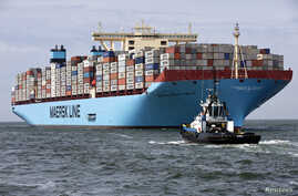 The MV Maersk Mc-Kinney Moller, the world's biggest container ship, arrives at the harbour of Rotterdam August 16, 2013. The 55,000 tonne ship, named after the son of the founder of the oil and shipping group A.P. Moller-Maersk, has a length of 400 m