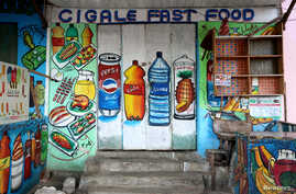 FILE - A mural on the exterior wall of a store illustrates food and drinks, in the Wabari district of Mogadishu, Somalia, June 8, 2017.