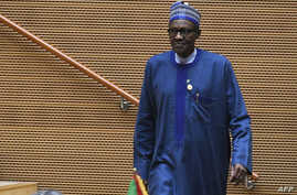 Nigeria's President Muhammadu Buhari walks after speaking at the opening of the Ordinary Session of the Assembly of Heads of State and Government during the 30th annual African Union summit in Addis Ababa, Jan. 28, 2018.