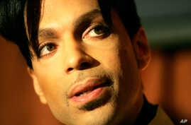 "Recording artist Prince speaks during a news conference about his recording agreement between himself and Universal Records and his new single ""Te Amo Corazon,"" Beverly Hills, California, Dec. 13, 2005."