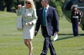FILE - White House senior adviser Kellyanne Conway, left, and White House Chief of Staff Reince Priebus walk across the South Lawn of the White House in Washington, May 17, 2017.