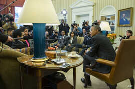 """President Barack Obama meets with a group of """"Dreamers"""" in the Oval Office of the White House in Washington, Feb. 4, 2015."""
