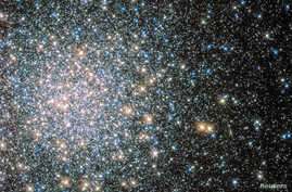 A globular star cluster called Messier 5 (M5) containing 100,000 stars or more and packed into a region around 165 light-years in diameter is seen in an undated image taken by NASA's Hubble Space telescope and released April 25, 2014.  Messier 5 lies