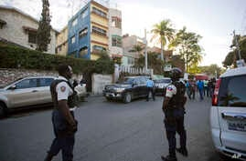 National police stand outside a radio station, center, after the arrest of Guy Philippe in Petion-Ville, Haiti, Jan. 5, 2017.