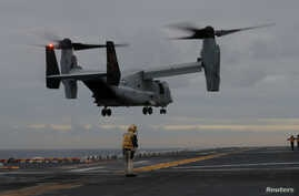 FILE - A U.S. Marines MV-22 Osprey Aircraft lands on the deck of the USS Bonhomme Richard amphibious assault ship off the coast of Sydney, Australia, June 29, 2017.