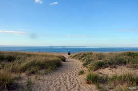 National parks traveler Mikah Meyer soaks in the picturesque seashore of Cape Cod, Massachusetts during an unseasonably balmy day in October.
