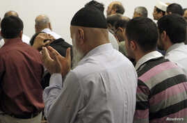 Members of the Chicago's Muslim community take part in afternoon prayer at the Downtown Islamic Center in Chicago, March 10, 2011..