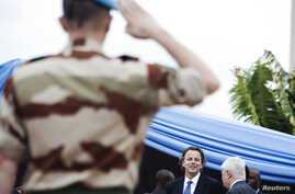 FILE - A soldier salutes U.N. Special Representative to Mali, Albert Koenders (2nd L), at a ceremony that marks the beginning of the 12,000-strong U.N. peacekeeping mission in Mali (MINUSMA) in Bamako, July 1, 2013.