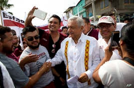 Presidential hopeful and two-time candidate Andres Manuel Lopez Obrador greets supporters as he arrives at a campaign rally for Delfina Gomez, who is running for Mexico state governor with his National Regeneration Movement, in Nezahualcoyotl, Mexico