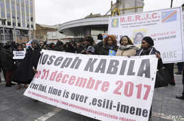 Members of Congolese associations calling on Joseph Kabila to step down as president of the Democratic Republic of the Congo take part in a demonstration in Brussels, Dec. 30, 2017.