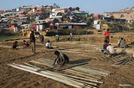 Rohingya refugees build shelter with bamboo at the Jamtoli camp in the morning in Cox's Bazar, Bangladesh, Jan. 22, 2018.