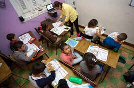 FILE - Students attend an English class at the Cuban School of Foreign Languages, in Havana, Cuba, Feb. 5, 2016. Despite ideological and legal hurdles, Cuba's blooming entrepreneurial system has quietly created something that looks very much like a p