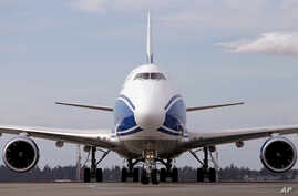 A new Boeing 787-8 freighter jet taxis after landing Oct. 7, 2016, at Seattle-Tacoma International Airport. The sale of hundreds of Boeing and Airbus jets is in jeopardy after the U.S. House of Representatives passed a bill Thursday, Nov. 17, 2016,  ...