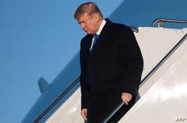 US President Donald Trump disembarks from Air Force One upon arrival at Joint Base Elmendorf-Richardson in Anchorage, Alaska, Feb. 28, 2019.