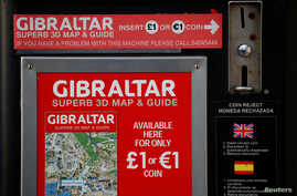 A vending machine selling tourist maps offers the chance to pay in pounds or euros in the British overseas territory of Gibraltar, historically claimed by Spain, April 20, 2017.
