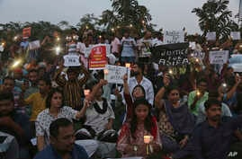 Indians participate in a candle light procession in protest against the rape and murder of 8-year-old Asifa Mohammad Yusuf Pujwala in Hyderabad, India, Friday, April 13, 2018.