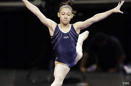 Kyla Ross leaps from the balance beam during practice for the U.S. Olympic gymnastics trials, June 27, 2012, in San Jose, California.
