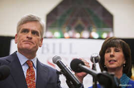 Republican U.S. Representative Bill Cassidy addresses supporters with his wife Laura after winning the runoff election for U.S. Senate against Democrat Mary Landrieu in Baton Rouge, Louisiana, Dec. 6, 2014.