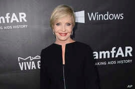 FILE - Florence Henderson arrives at the 2014 amfAR Inspiration Gala at Milk Studios in Los Angeles.