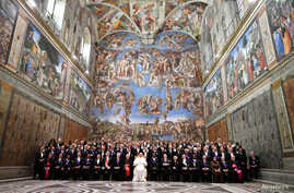 Pope Francis poses in the Sistine Chapel with members of the diplomatic corps accredited to the Holy See at the end of an audience for the traditional exchange of New Year greetings at the Vatican, Jan. 9, 2017.