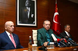 Turkey's President Recep Tayyip Erdogan, center, speaks to the media at Ataturk Airport before his departure for London for a two-day official visit, in Istanbul, May 13, 2018.