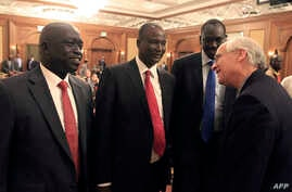 FILE - Members of South Suda'sn rebel delegation talk with US Envoy to Sudan and South Sudan Mr. Donald E. Booth (R) on Jan. 4, 2014 during talks in Addis Ababa to try and broker a ceasefire between Salva Kiir led government forces and rebels allied