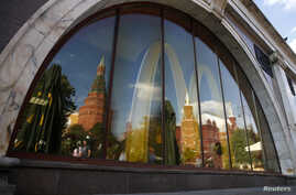 The walls and towers of the Kremlin are reflected in a window of a closed McDonald's restaurant, one of four temporarily closed by the state food safety watchdog, in Moscow, August 21, 2014.
