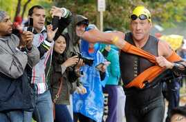 Lance Armstrong competes in the Rev3 Half Full Triathalon Sunday, Oct. 7, 2012 in Ellicott City, Md. Armstrong joined other cancer survivors in the event which raised funds for the Ulman Cancer Fund for Young Adults. (AP Photo/Steve Ruark)