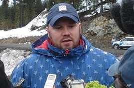 'USA-1' Bobsled driver Steve Holcomb talks to the media
