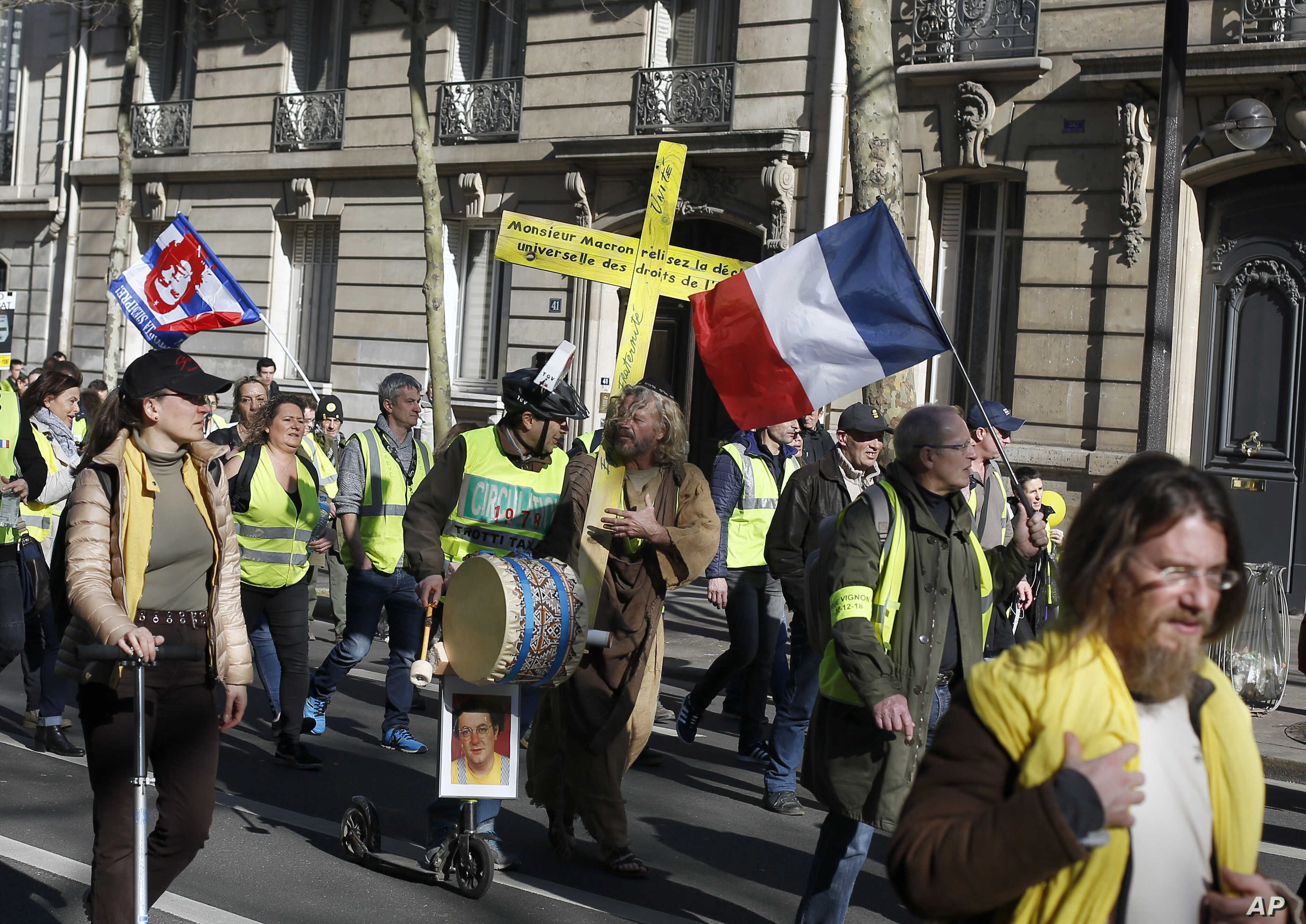 Yellow vest protesters march during a protest in Paris, France, Feb. 17, 2019.