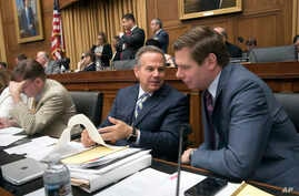 FILE - Rep. David Cicilline, D-R.I., center, talks with Rep. Eric Swalwell, D-Calif., right, during a House Judiciary Committee meeting on Capitol Hill, June 26, 2018.