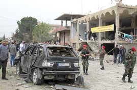 Lebanese security forces inspect the site of a suicide car bomb attack in Al-Nabi Othman, the Bekaa Valley, near the Syrian border on March 17, 2014.