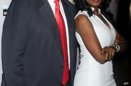 "FILE - Donald Trump and Omarosa Manigault are seen at ""The All-Star Celebrity Apprentice Event."""