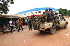 Militias of the Seleka alliance drive past stalls at the central market in Bangui, Central African Republic, in March, 2013. Aid groups and the international community on Tuesday condemned widespread looting after a coup .