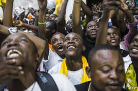 Supporters of newly re-elected Congo President Denis Sassou Nguesso celebrate his victory in Brazzaville on March 24, 2016 after the Independent Electoral Commission declared him the winner.