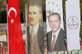 FILE - Banners with pictures of modern Turkey's founder Ataturk and Turkish President Tayyip Erdogan are pictured during the opening ceremony of Recep Tayyip Erdogan Imam Hatip School in Istanbul, Turkey, Sep. 29, 2017.
