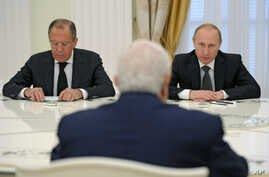 FILE - Syrian Foreign Minister Walid al-Mualem, front, meets with Russian President Vladimir Putin and Russian Foreign Minister Sergey Lavrov, left, in Moscow's Kremlin, June 29, 2015.