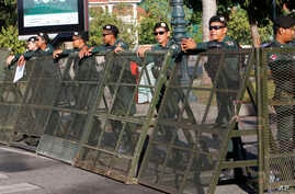 Riot police stand guard at a blocked street outside the Supreme Court in Phnom Penh, Cambodia, Nov. 16, 2017.