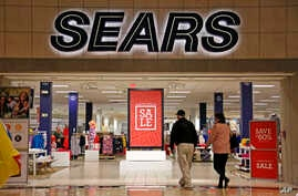 In this Feb. 8, 2017, photo, shoppers walk into a Sears store in Pittsburgh.