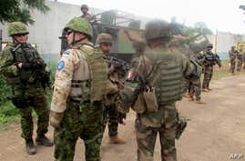 Soldiers of the European Union Force RCA (EUFOR RCA) patrol in Bangui, CAR, January 19, 2015, after two aid workers, including a 67-year-old French woman, were kidnapped in the capital the French government said.