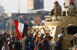 Supporters of Egypt's President Abdel-Fattah el-Sissi cheer at soldiers during a demonstration against the Muslim Brotherhood and other Islamist groups at Tahrir Square in Cairo, Nov. 28, 2014.