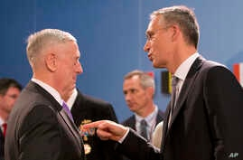 U.S. Secretary for Defense Jim Mattis, left, speaks with NATO Secretary General Jens Stoltenberg during a meeting of NATO defense ministers at NATO headquarters in Brussels, June 29, 2017