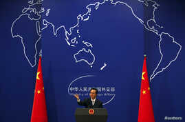 FILE - China's Foreign Ministry spokesman Hong Lei conducts a news conference in Beijing.
