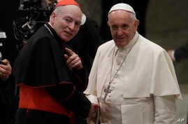 Pope Francis, right, shakes hands with Cardinal Carlos Aguiar Retes, at the Vatican, Nov. 23, 2016. on Thursday Francis appointed Aguiar archbishop of Mexico City.